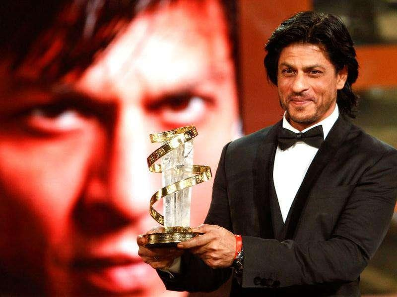 Shah Rukh Khan poses with his trophy after receiving award for his lifetime career during the 11th Marrakech International Film Festival in Marrakech, Morocco.