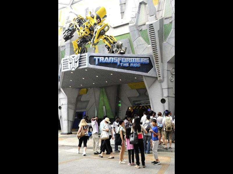 Visitors queue for the Transformers-themed amusement park ride at Universal Studios Singapore. Transformers: The Ride is based on the Transformers movie franchise directed by Michael Bay.