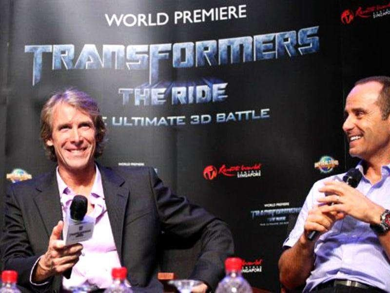 US film director Michael Bay (C) talks during a press conference at a media preview for Transformers: The Ride at Universal Studios Singapore. The themed amusement park ride is based on the Transformers movie franchise directed by Bay.