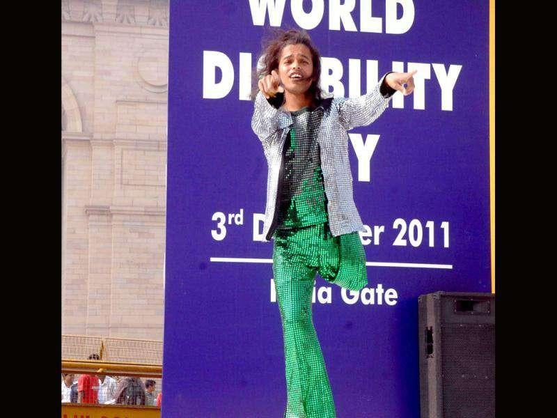 A physically challanged person participating in a dance drama on the occasion of World Disability Day at India Gate in New Delhi. UNI