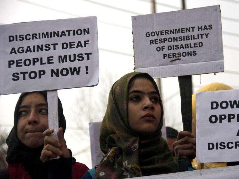 Members of the All Jammu and Kashmir Association of the Deaf hold plea cards during a protest in Srinagar.HT