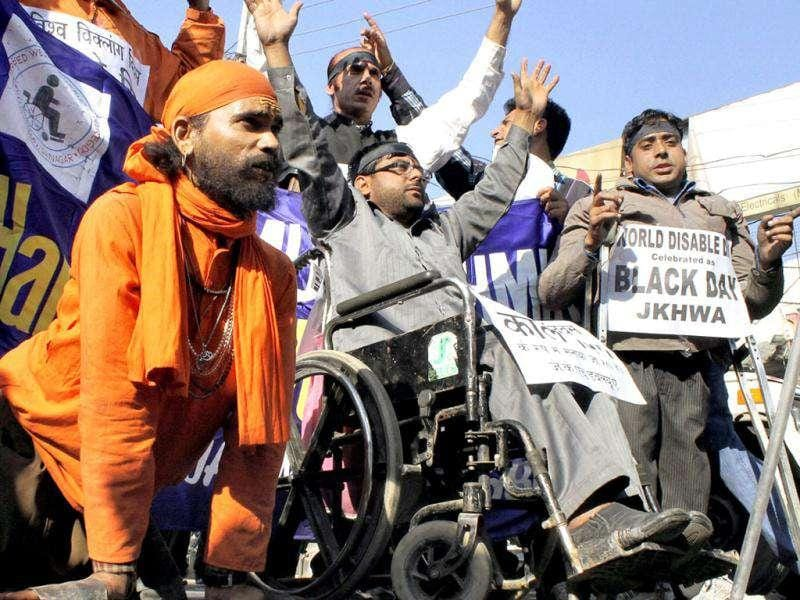 "Members of All Jammu and Kashmir Handicapped Association (AJKHA) shout slogans during a rally to mark ""World Disability Day"" in Jammu. PTI"