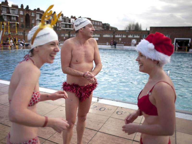 Swimmers chat after taking part in the annual outdoor December Dip swim at Parliament Hill Lido on Hampstead Heath in north London. (AP Photo/Matt Dunham)