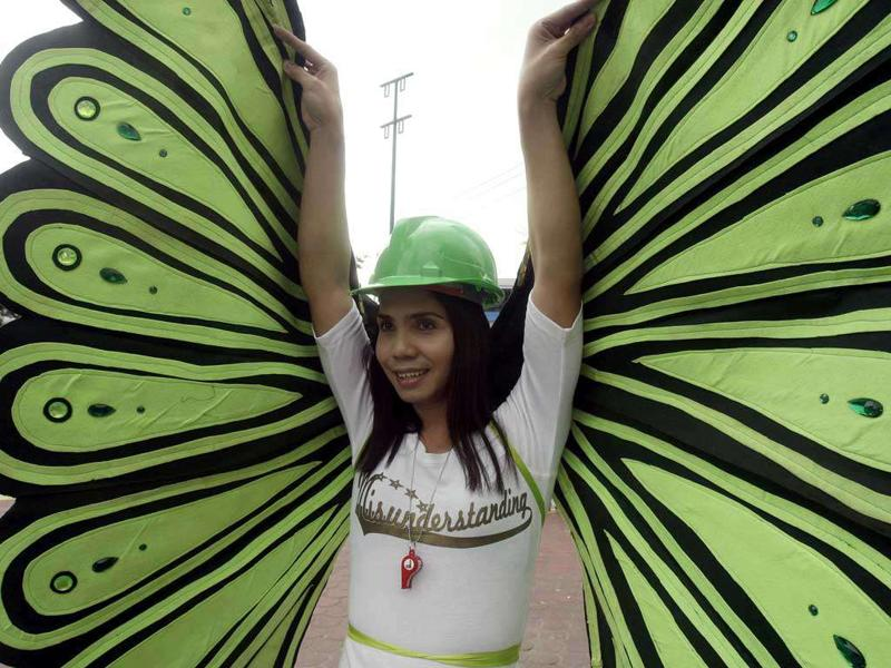 A gay participant spreads his butterfly wings during the annual Pride March in Manila, Philippines.