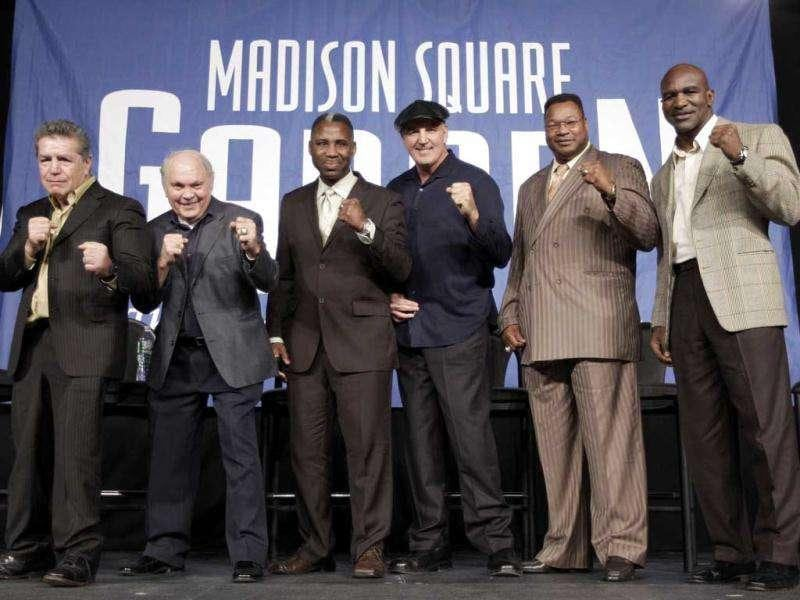 Boxers luminaries, from left, Vito Antuofermo, Carlos Ortiz, Marvis Frazier, Gerry Cooney, Larry Holmes, and Evander Holyfield pose for photographers during a round table discussion prior to the WBA super welterweight title fight between Miguel Cotto and Antonio Margarito at Madison Square Garden in New York.