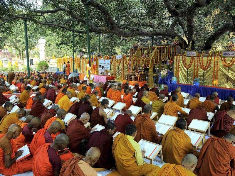 Devotees at the Tripitaka Chanting Ceremony to mark the 2600th Anniversary of the Enlightenment of the Buddha in Bodhgaya on Saturday. PTI Photo