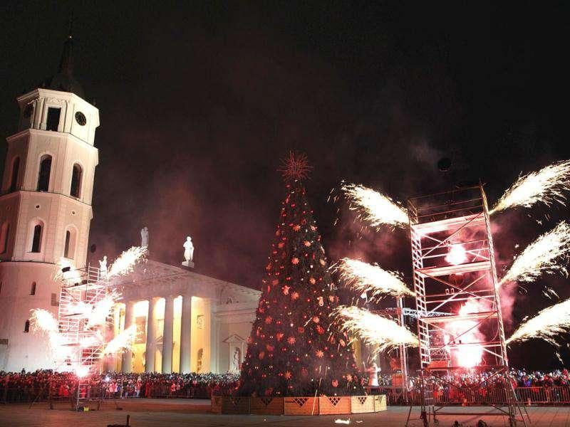 Fireworks light up the sky above a Christmas tree during the Christmas tree lighting ceremony at Cathedral square in Vilnius, Lithuania. AP