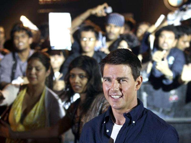 Tom Cruise obliges shutterbugs before a special screening of his film Mission Impossible: Ghost Protocol in Mumbai. AP/Rajanish Kakade