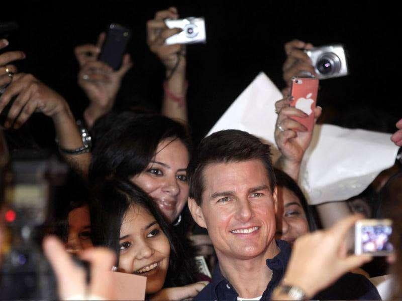 Cameras were everywhere as Tom Cruise dazzled them all with a smile. AP/Rajanish Kakade