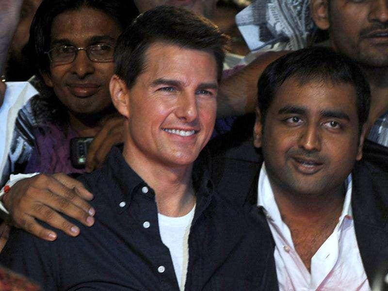 A fan has a little me-time with Tom Cruise in Mumbai. AFP/Indranil Mukherjee