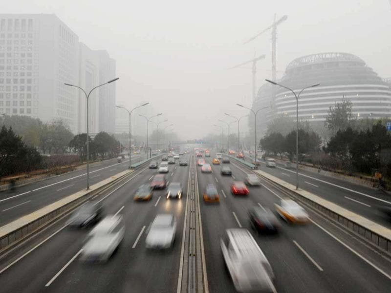 Cars travel on the second ring road as pollution reaches what the US Embassy monitoring station says are