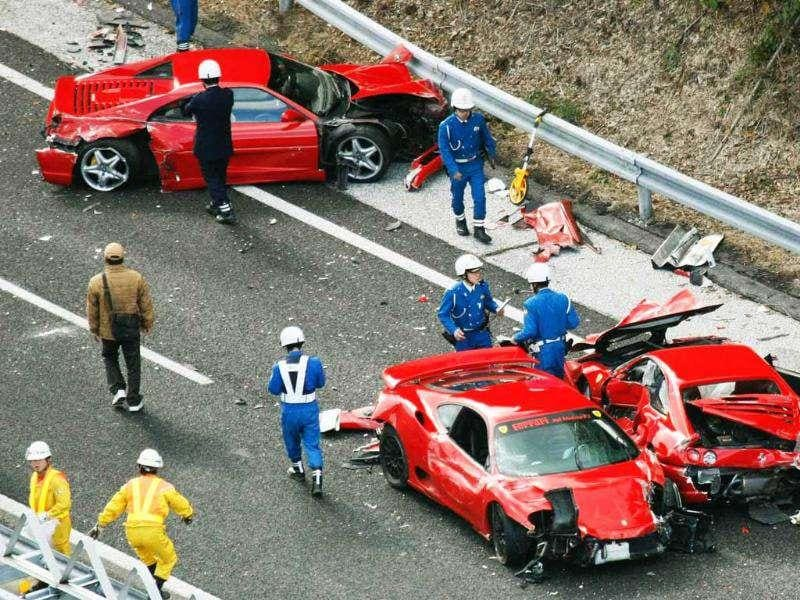 Police officers investigate wrecked luxury cars at the site of a traffic accident on the Chugoku Expressway in Shimonoseki, southwestern Japan in May 2011. Reuters photo