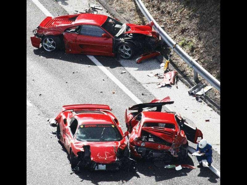 Police officers investigate wrecked luxury cars at the site of a traffic accident on the Chugoku Expressway in Shimonoseki, southwestern Japan. Reuters/Kyodo