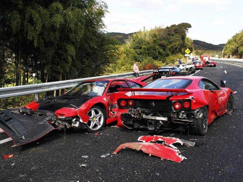 A damaged Ferrari sports car lies along a stretch of the Chugoku highway in Shimonoseki, western Japan following a 14-vehicle pile up. 8 Ferraris, 3 Mercedes-Benzes and a Lamborghini were involved in the accident on the highway in western Japan in May 2011, with 10 people taken to hospital but none seriously injured. AFP/Yomiuri Shimbun