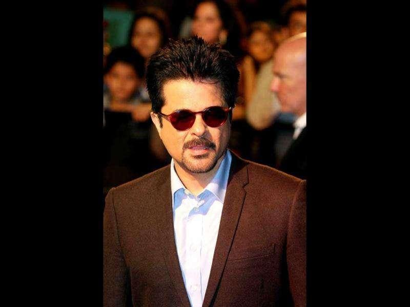 Anil Kapoor, in a black suit, looks half his age. AFP photo