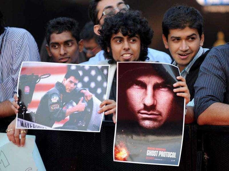 Indian fans waiting eagerly for the stars with posters in their hands. AFP PHOTO/Indranil Mukherjee
