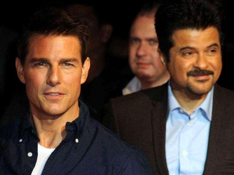 Tom Cruise along with Anil Kapoor at the red carpet. AFP PHOTO/Indranil Mukherjee