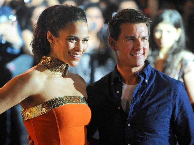 Paula looks stunning in an orange gown along with Tom Cruise. AFP PHOTO/Indranil Mukherjee