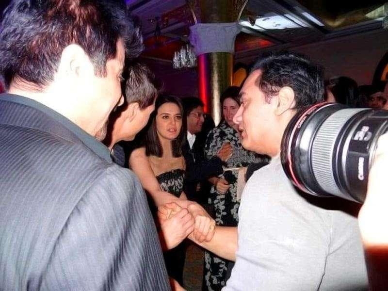 Hands off! Preity Zinta seems to be preventing Aamir Khan from shaking hands with Tom Cruise, while Anil Kapoor looks on. (Photo Courtesy: Bubbles, Pinkvilla)