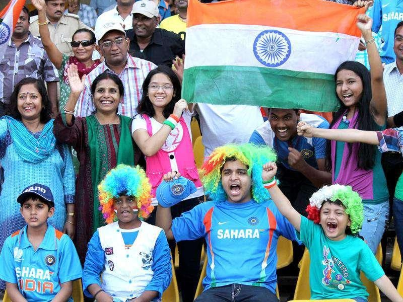 Cricket fans wave the triclour during the third ODI of the series between India and West Indies at Sardar Patel Motera Stadium in Ahmedabad.