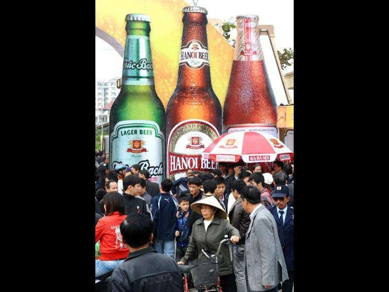 People arrive at the Hanoi Beer festival held in downtown Hanoi.