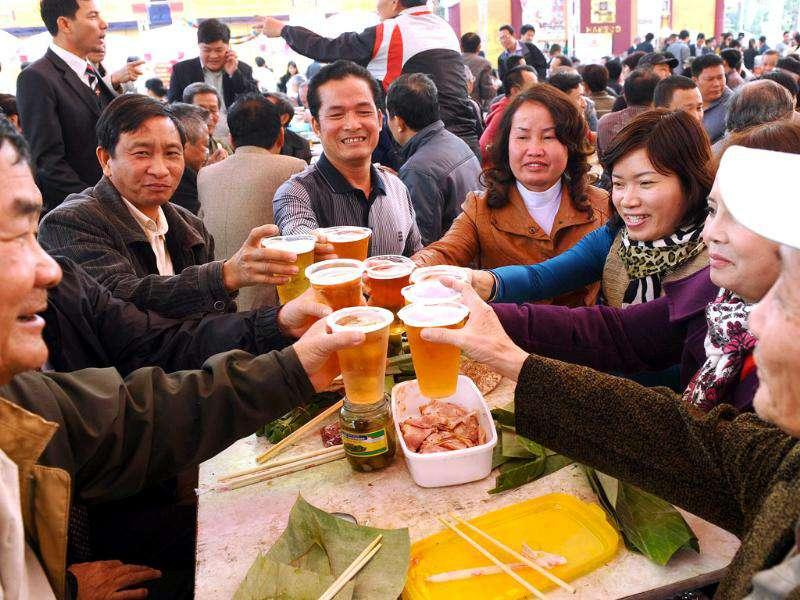 Drinkers attend the Hanoi Beer festival held in downtown Hanoi.