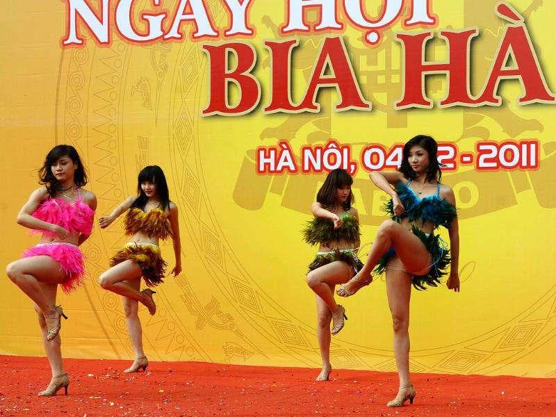 Dancers perform at the Hanoi Beer festival.