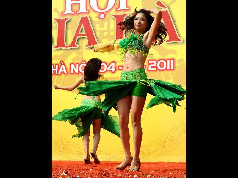Dancers perform at the Hanoi Beer festival held in downtown Hanoi. With a $1 entrance ticket people drank free