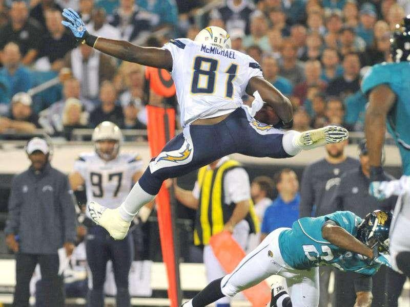 Tight end Randy McMichael #81 of the San Diego Chargers jumps over cornerback Kevin Rutland #22 of the Jacksonville Jaguars in a Monday Night Football game at EverBank Field in Jacksonville, Florida. Al Messerschmidt/AFP