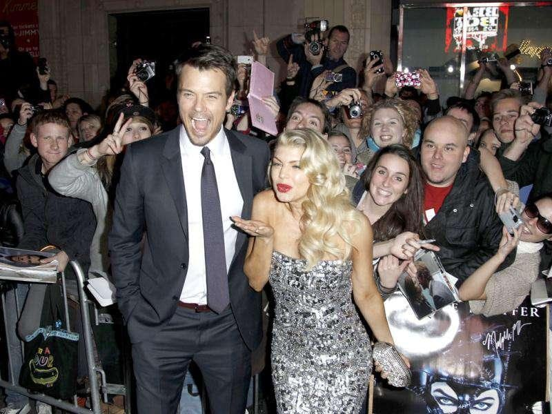 Josh Duhamel and Fergie arrive at the premiere of New Year's Eve in Los Angeles. AP Photo/Matt Sayles