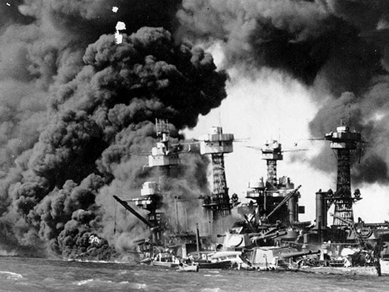 US Navy battleship USS West Virginia burns and sinks after the Japanese attack on Pearl Harbor, Hawaii on December 7, 1941.