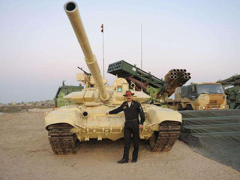 Lieutenant General AK Singh army commander pose besides a T-90 battle tank after briefing media persons during the Indian Army Exercise Sudarshan Shakti in Barmer district in Rajasthan. Exercise Sudarshan Shakti displayed the maneuver by mechanised forces and all other components on air and land battle concept.