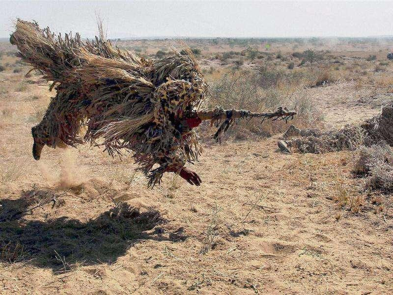 An Indian Army jawan participates in the Indian Army exercise Sudarshan Shakti at Bugundi battle-field near Barmer in Rajasthan.
