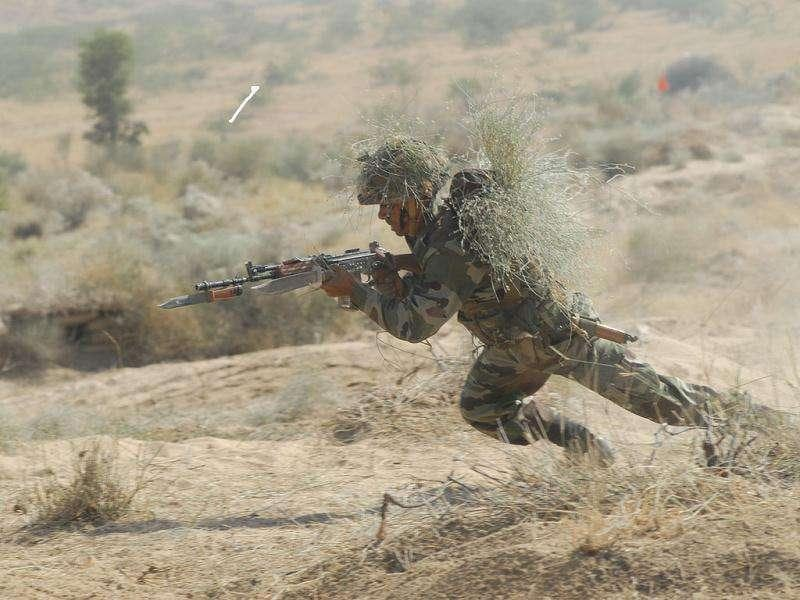 An Indian Army jawan in action during the Indian Army exercise Sudarshan Shakti 40 km south east of Barmer.