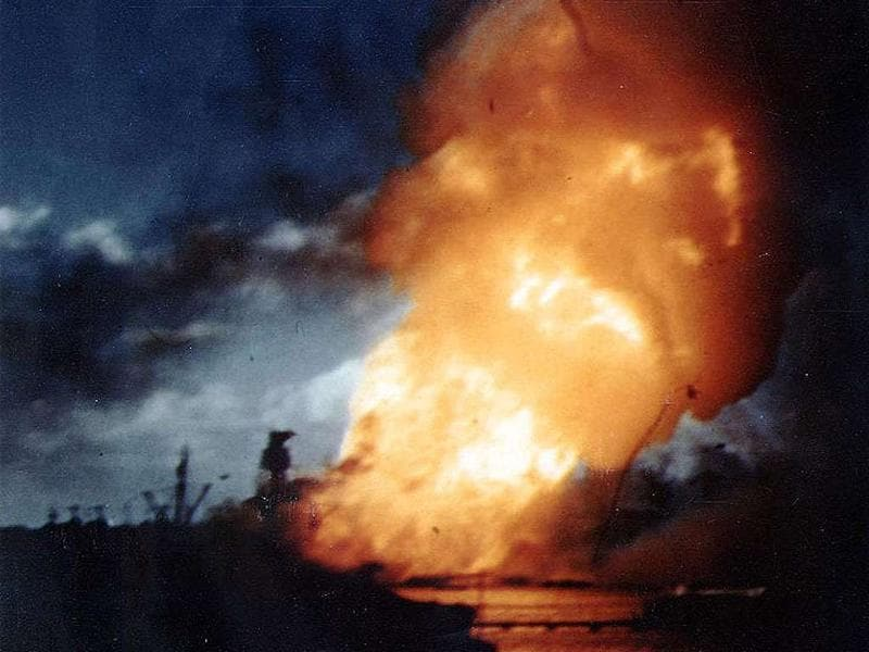 The USS Arizona is seen ablaze, immediately following the explosion of its forward magazines after the Japanese attack in Pearl Harbor, Hawaii on December 7, 1941.