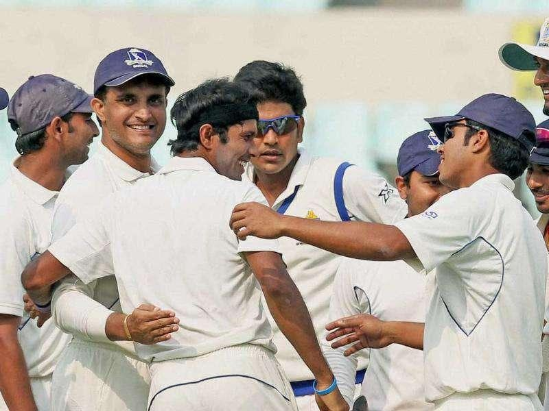 Bengal cricketer Sourav Ganguly and others celebrate the fall of a Tamil Nadu during their Ranji Trophy match at Eden Garden in Kolkata. PTI Photo by Ashok Bhaumik
