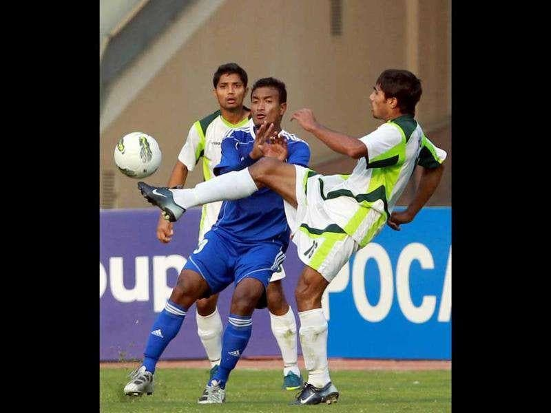 Nepal's Biraj Maharajan vies for the ball with Pakistan footballer Hasnain Abbas during their match at the South Asian Football Federation Championship 2011, in New Delhi. PTI Photo by Manvender Vashist