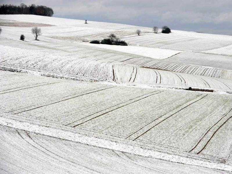 A field is covered with snow in Salzberg, near Hersfeld-Rothenburg, western Germany. Snow is forecast over the next weeks in German higher ground. AFP photo