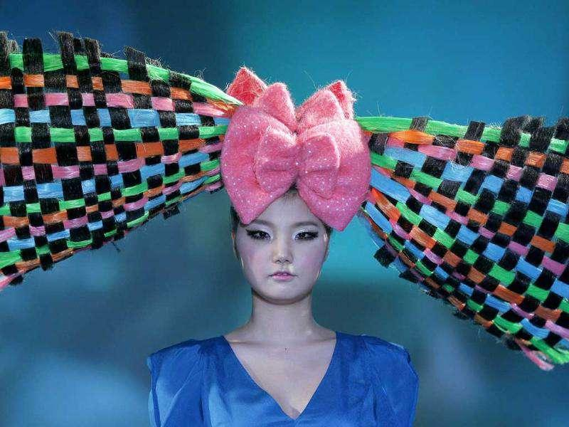 A model presents a headgear in the shape of a bow during the Korea Hair Collection in Seoul. Reuters/Jo Yong-Hak