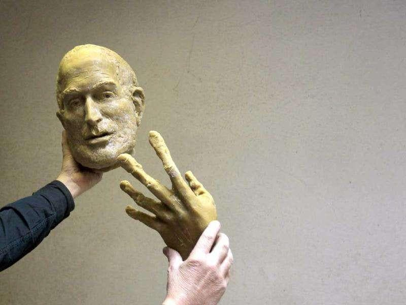 Hungarian sculptor Erno Toth holds up a face and a hand of a wax model for a new bronze statue of late Apple co-founder Steve Jobs in Budapest. Reuters /Laszlo Balogh