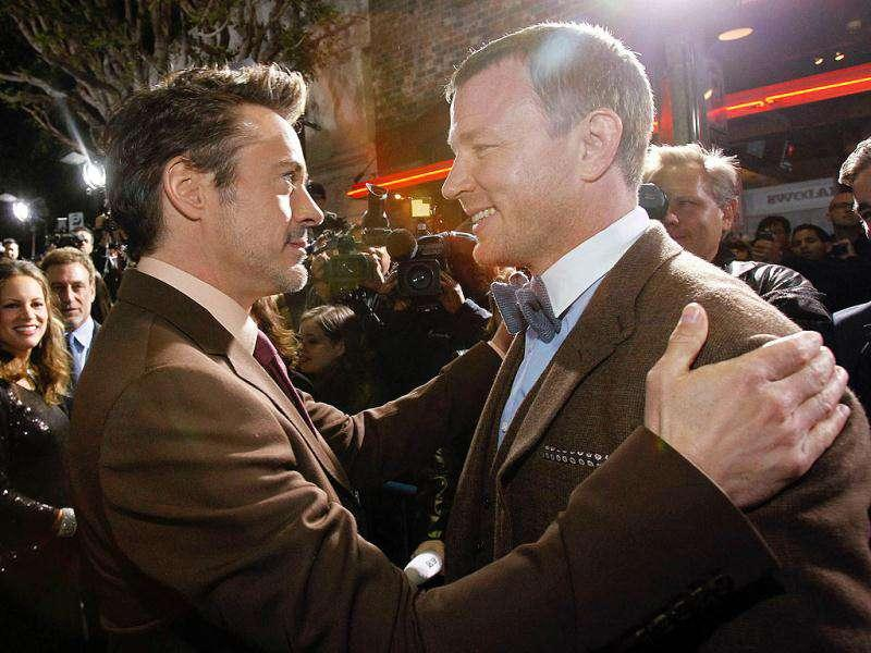 Robert Downey Jr. mingles with co-star Guy Ritchie.
