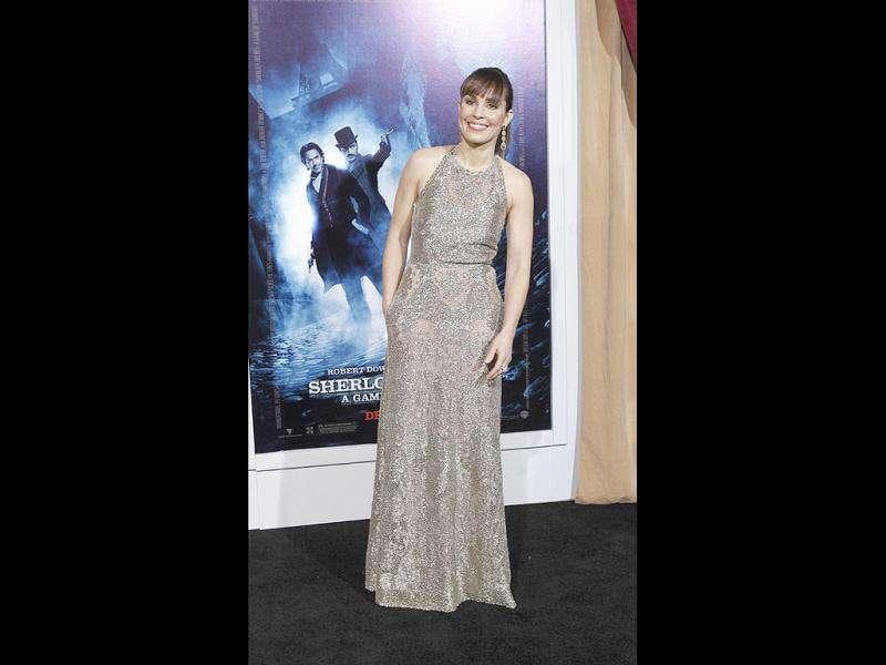 Actor Noomi Rapace pose in a silver gown.