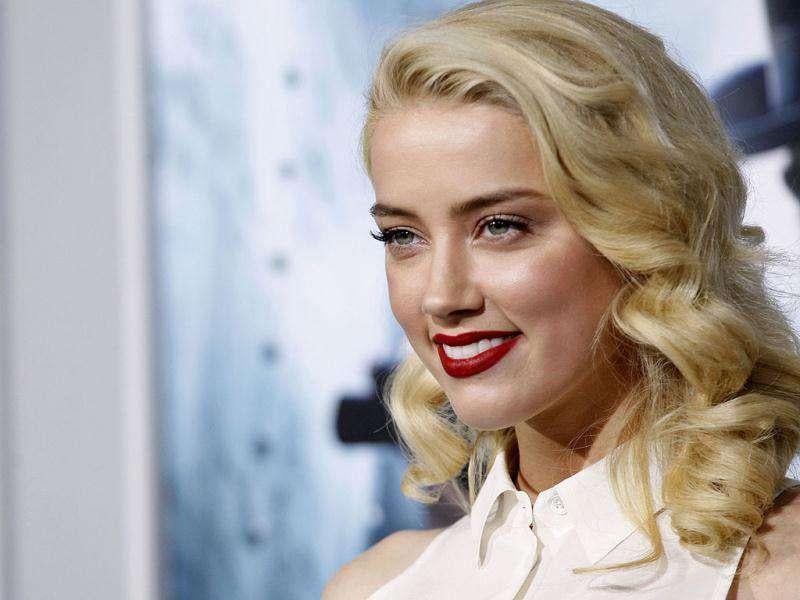 Actor Amber Heard strikes a smile at the premiere of Sherlock Holmes: A Game of Shadows in Los Angeles on Dec. 6.