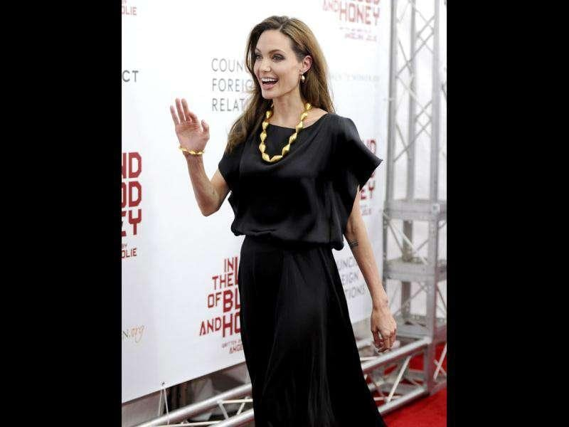 Jolie looked chic in a plain black dress teamed with chunky gold jewellery. (Reuters)