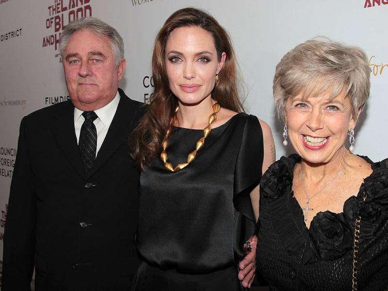 Meet the parents: Angelina (C) with Brad Pitt's parents, Bill (L) and Jane (R). (Reuters)
