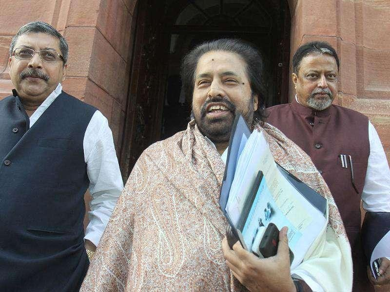 Trinamool Congress MPs Sudip Bandyopadhyay (C) and Mukul Roy (R) after attending the all-party meeting on the issue of FDI in retail at Parliament House in New Delhi. HT/Sonu Mehta