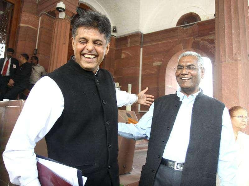 Congress MP Manish Tiwari and D Raja after attending the Parliament winter session, in New Delhi. HT/Sonu Mehta