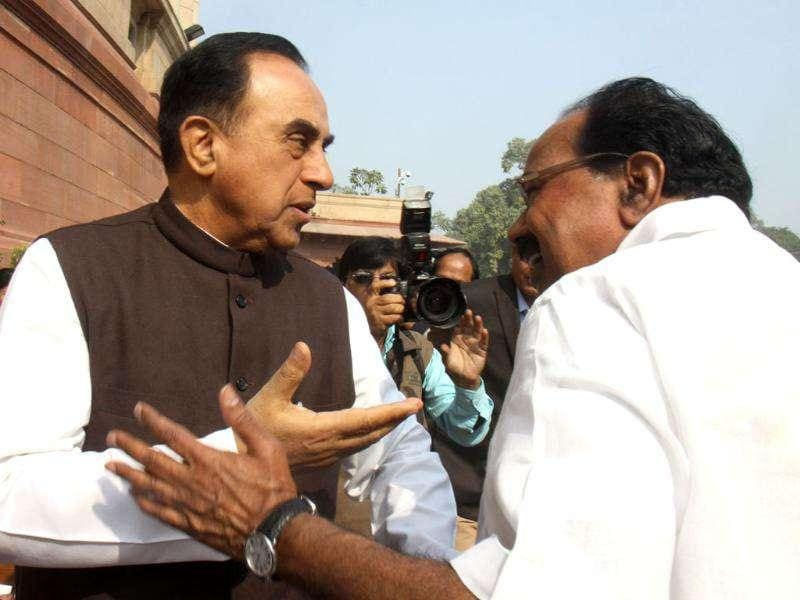 Corporate affairs minister M Veerappa Moily with Janta Party president Subramanian Swamy at Parliament House during the winter session, in New Delhi. HT/Sonu Mehta