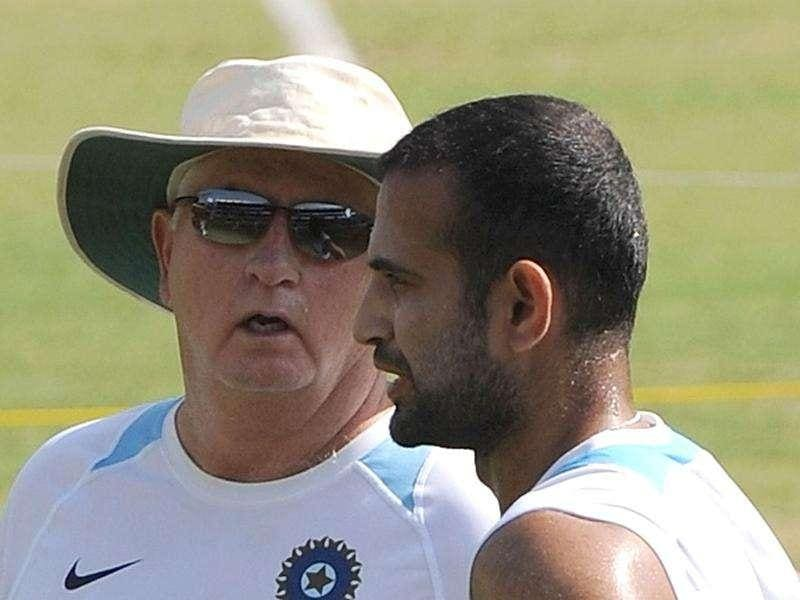 Irfan Pathan (R) speaks with coach Duncan Fletcher during a practice session at The Holkar Stadium in Indore. AFP Photo
