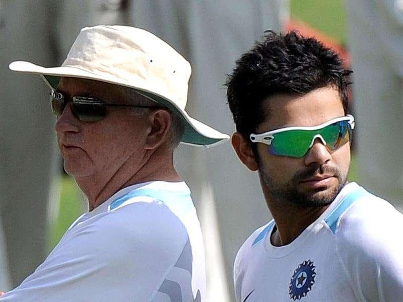 Virat Kohli (R) listens to coach Duncan Fletcher during a practise session at The Holkar Stadium in Indore. AFP Photo